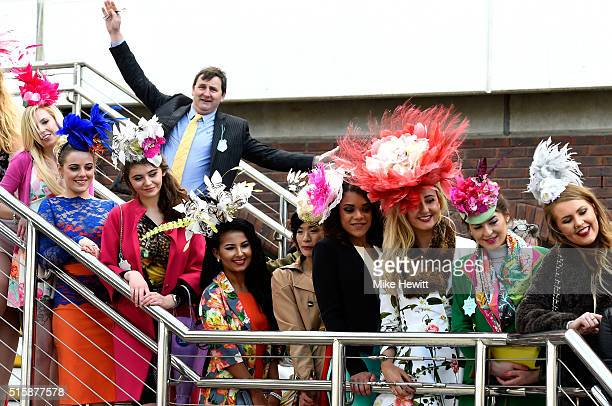 A group of racegoers pose for a photograph during Ladies Day of the Cheltenham Festival at Cheltenham Racecourse on March 16 2016 in Cheltenham...