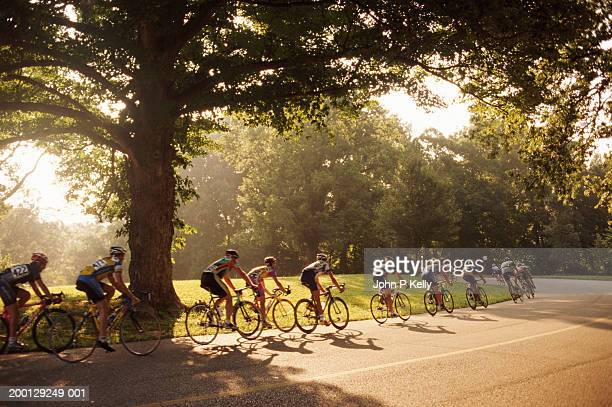 group of racing cyclists - sports race stock pictures, royalty-free photos & images