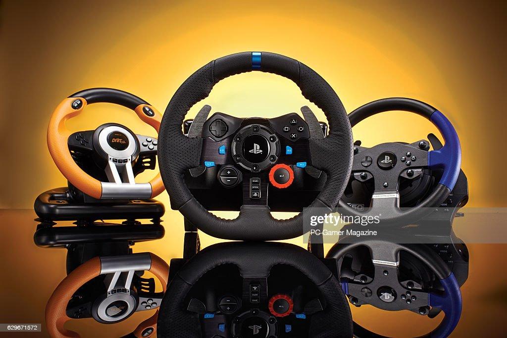 A group of racing wheels, including a Speedlink Drift O Z , Logitech