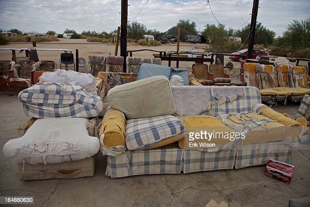 Group of ragged couches and chairs ring an outdoor stage at Slab City, near Niland, just south of the Salton Sea.