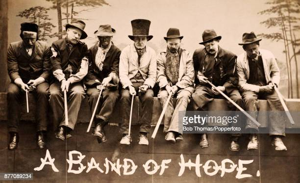 A group of raggedy men fishing for work or opportunities more in hope than in expectation circa 1905