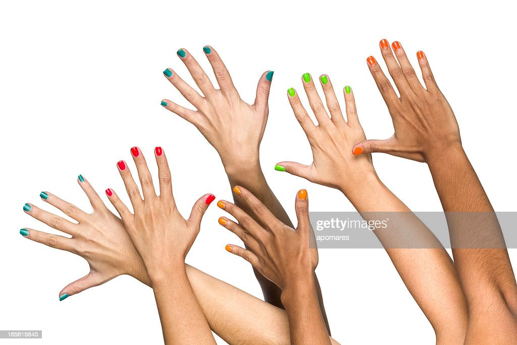 Group of raised multiethnics female hands with colored manicure : Stock Photo