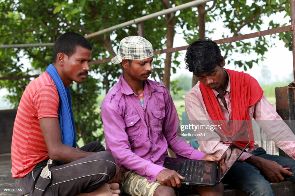 Group of real people sitting in the nature & using laptop : Stock Photo