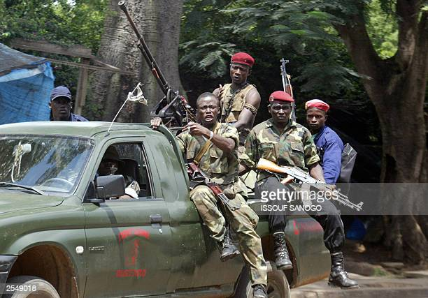 Group of rebels of Sherif Ousmane forces are seated on a pickup with a heavy machine gun after they trade fire with the ex-rebels of the New forces...