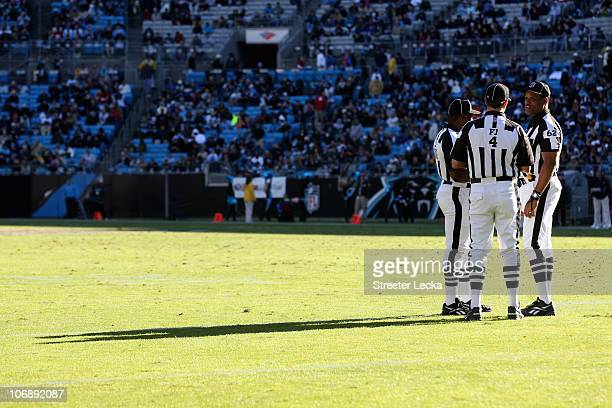 Group of referees huddle during their game between the New Orleans Saints and the Carolina Panthers during their game at Bank of America Stadium on...
