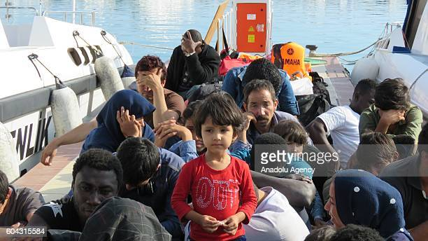 A group of refugees are seen after they were captured by coast guard while they were trying to pass illegally to Lesbos of Greece from Ayvacik's...