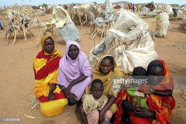 A group of refugees from Adwa who fled their village when it was attacked by Janjaweed July 17 2004 During the attack children were thrown into fires