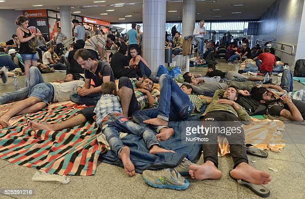 A group of refugees from Syria at Budapest Keleti railway station as for the second day migrants camp out at the train station facilities Tuesday 2...