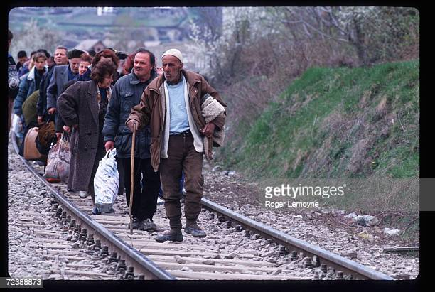 A group of refugees walk along railroad tracks April 1 1999 in Macedonia Thousands of Kosovar Albanians fled the violence in Serbia and arrived at...
