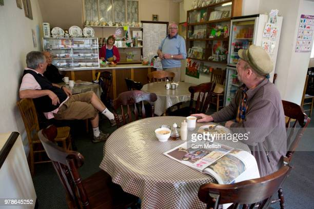 A group of regular customers chat with one another at Caffi Trefermy on the 20th April 2011 in Corwen in the United Kingdom