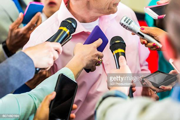 a group of reporters interview political candidate - town hall meeting stock photos and pictures