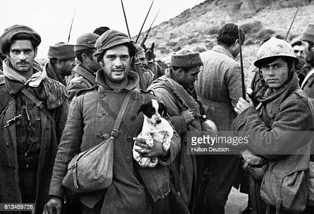 A group of Republican soldiers talk to journalists during the Spanish Civil War including the American novelist Ernest Hemingway who served as a war...