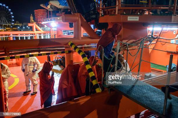 A group of rescued migrants being transferred from the vessel to the Red Cross tent On 11 November 2018 in Malaga Spain The Maritime Spanish Vessel...