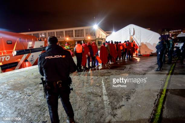 A group of rescued migrants queuing at the entrance of the Red cross tent to be attended by the team Malaga The Spaniard Maritime vessel rescued in...