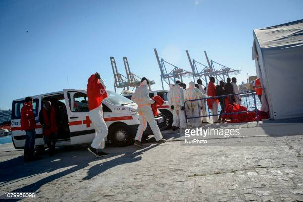 A group of rescued migrants queuing at the entrance of the Red cross tent on January 9 Malaga Southern Spain
