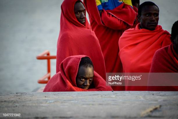 A group of rescued migrants waiting on the board the vessel to be transferred to the Red cross tent in the port of Malaga on October 6 2018