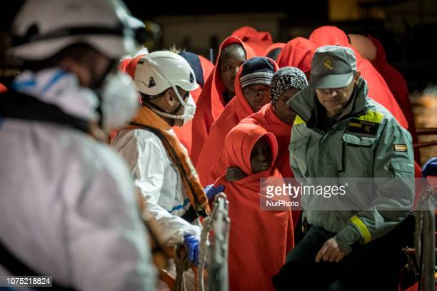 A group of rescued migrants waiting to be transferred to the Care unit on 22 December 2018 in Malaga Spain 120 migrants were recued from the danger...