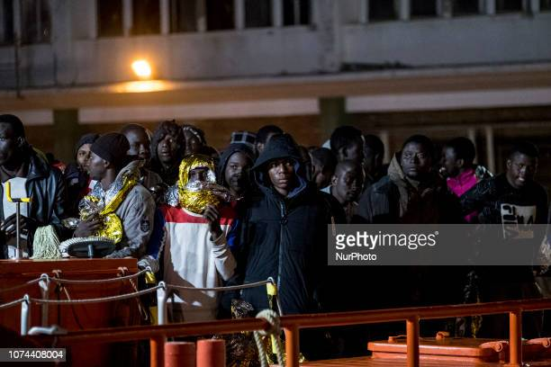 A group of rescued migrants waits onboard the Spanish Maritime vessel before being taken to the Care unit of the Red cross Malaga Spain
