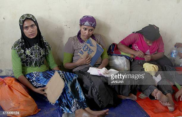 A group of rescued women migrants mostly Rohingya from Myanmar and Bangladesh rest upon their arrival at the new confinement area in the fishing town...