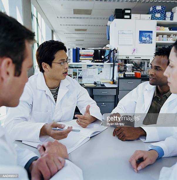Group of research scientists meeting in research lab