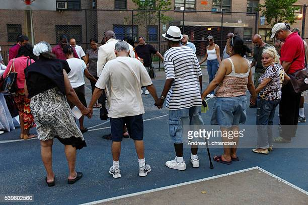 A group of residents at a public housing project in the South Project pray for a resident who died in police custody after being stopped during a...