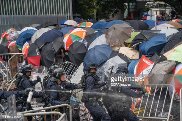 A group of riot police try to attack the protester's front line Thousands of protesters occupied the roads near the Legislative Council Complex in...