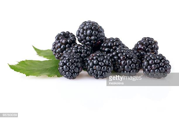 a group of ripe blackberries with leaves - blackberry fruit stock pictures, royalty-free photos & images