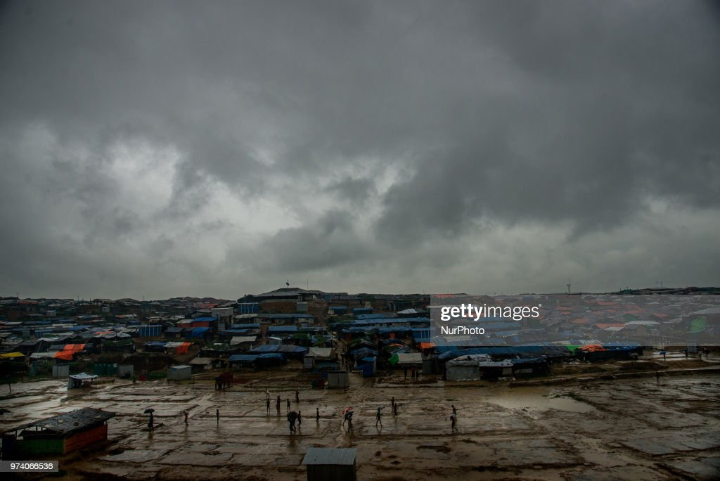 A group of rohingya refugee is playing football on the empty ground of a rohingya makeshift shelterr at kutupalong in Coxs Bazar, Bangladesh on June 13, 2018. Hundreds of tents of rohingya has taken to the another place as thir living place was threaten for being flooded.