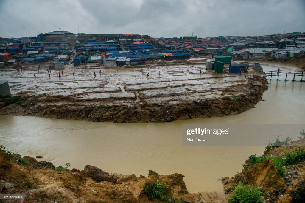 A group of rohingya refugee is playing football on the empty ground rohingya makeshift shelterr at kutupalong in Coxs Bazar, Bangladesh on June 13, 2018. Hundreds of tents of rohingya has taken to the another place as thir living place was threaten for being flooded.
