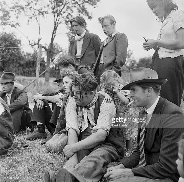A group of Romany people at an encampment at Corke's Meadow in Kent July 1951 Original publication Picture Post 5363 The Unromantic Gypsies pub 28th...