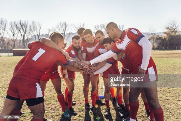 group of rugby players huddling during time out - adults only stock pictures, royalty-free photos & images