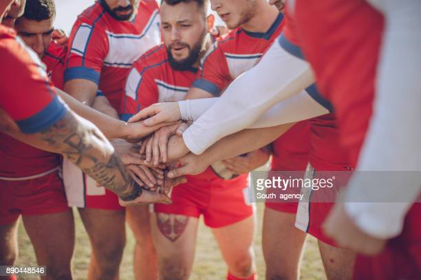 Group of rugby players huddling