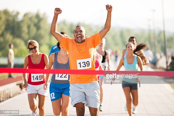 group of runners in a cross country race - finish line stock pictures, royalty-free photos & images