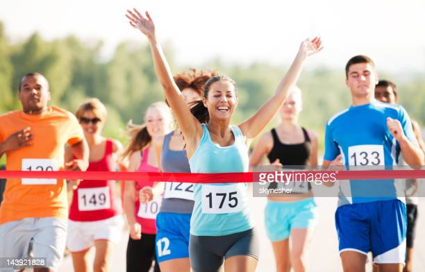 group of runners in a cross country race. - finishing stock pictures, royalty-free photos & images