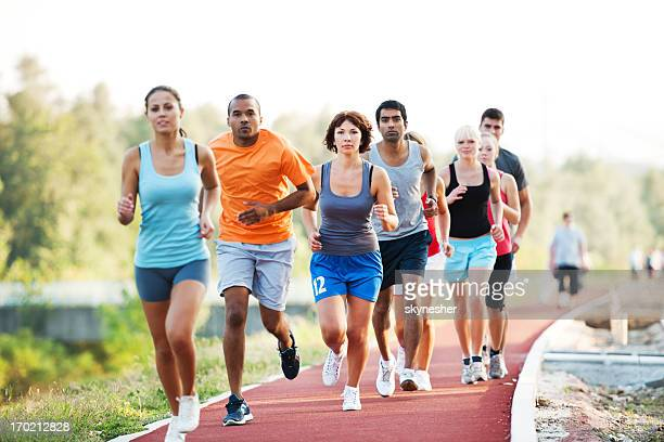 group of runners in a cross country race. - 5000 meter stock pictures, royalty-free photos & images