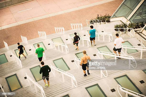 Group of runners training on convention center steps