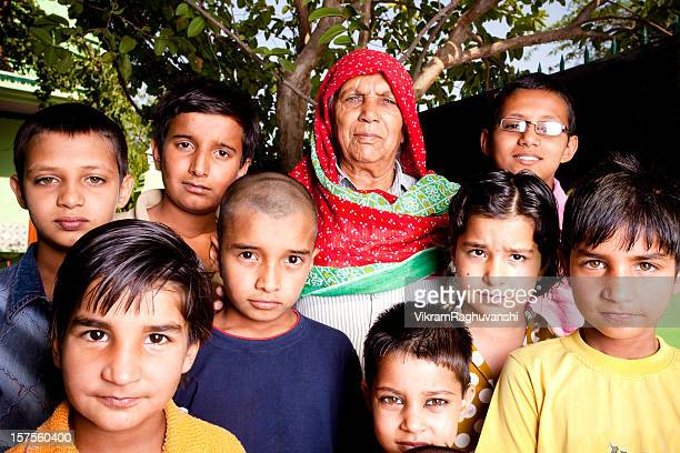 group of rural indian children with their grandmother - asian granny pics stock photos and pictures