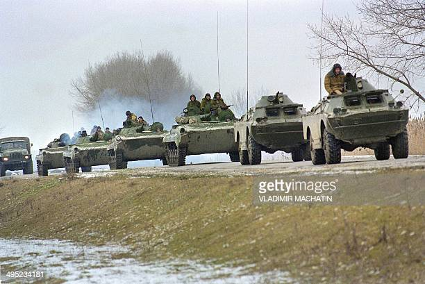 A group of Russian APCs moves to the village of Pervomaiskaya in Dagestan where 250 Chechen fighters are still holding about 150 hostages 13 January...