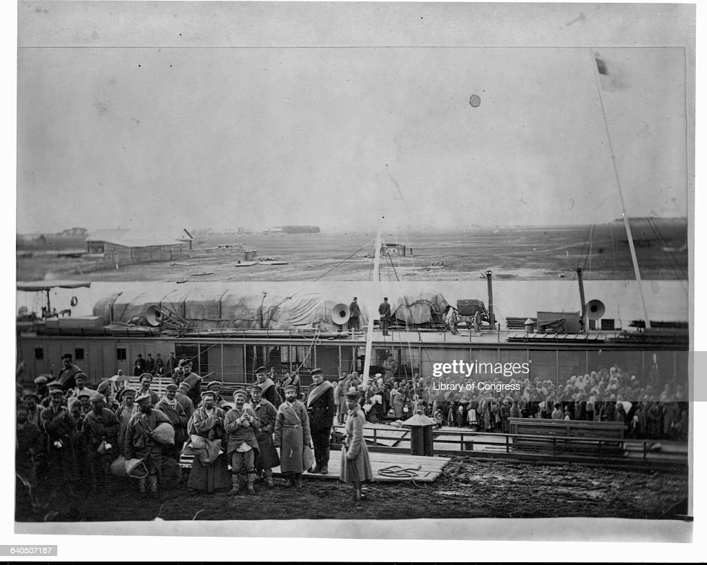 A group of Russian convicts and exiles board a river barge in Tiumen, Western Siberia. ca. 1885. | Location: Tiumen, Western Siberia, Russia.
