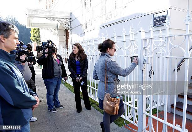 A group of Russian people gather in front of the Russian embassy in San Francisco USA on December 29 2016 after the US on Thursday applied...
