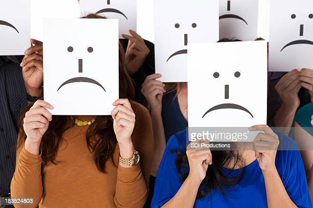 Group of Sad Face Emoticon Cards Being Held