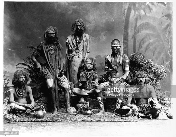 A group of sadhus or fakirs Hindu holy men The man second from right clearly wears the bands which indicates he is a devotee of Shiva