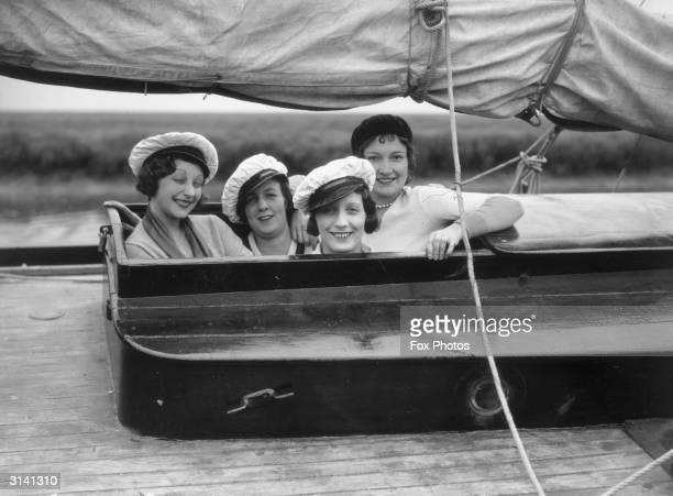 A group of 'sailing belles' framed in the hatch of their yacht at Canvey Island