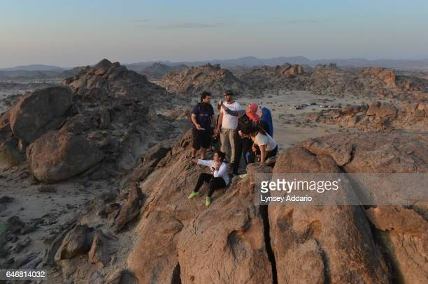 A group of Saudis and a few foreigners hike through the desert/ mountains about 50 miles North east of Jeddah in Al Kamel