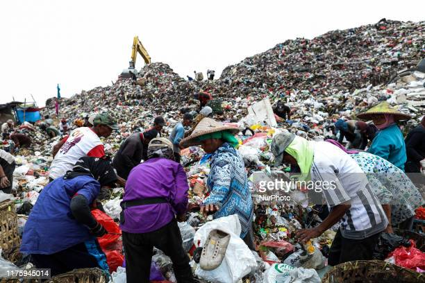 A group of scavengers searches for items and plastics to sell for recycling at Rawa Kucing landfill in Tangerang Banten province Indonesia on 14...