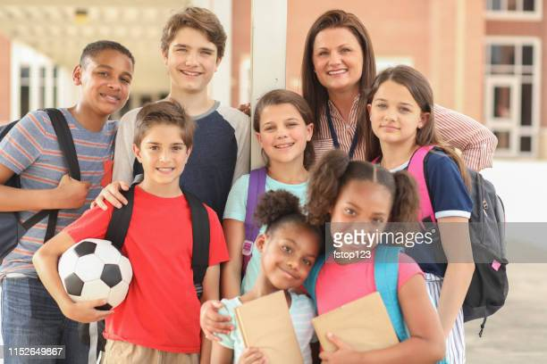 group of school children, friends and teacher on campus. - junior high student stock pictures, royalty-free photos & images