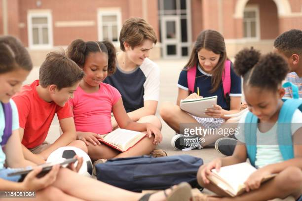 group of school children, friends studying together on campus. - junior high student stock pictures, royalty-free photos & images