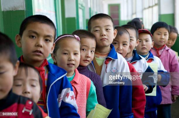 A group of school children line up to receive the vaccination against Hepatitis B in Ledu Qinghai China on Monday Sept 17 2007 Run by the Asian Liver...