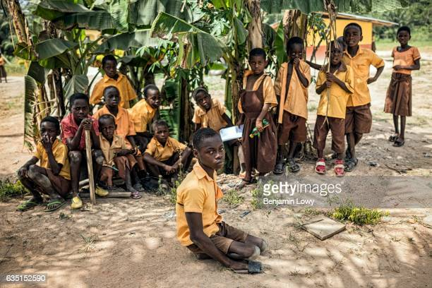 A group of school children wait for their teachers in Assin Ghana where the school system is supported by funds from a chocolate conglomerate...