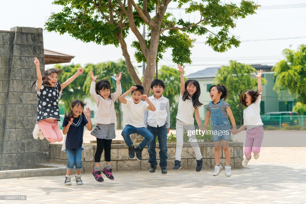 Group of school friends outdoors : Stock Photo